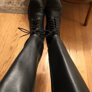 Black zip boots with shoe tie style